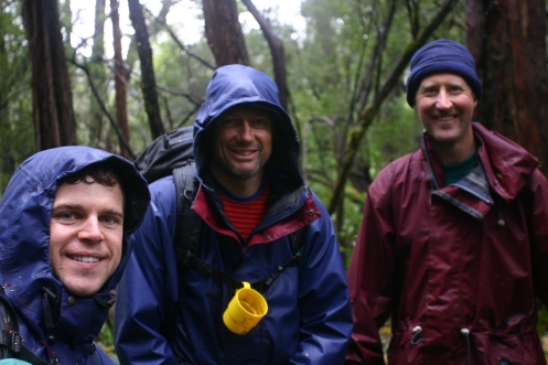 Matt, Richard, Dale, in the scrub, in the rain