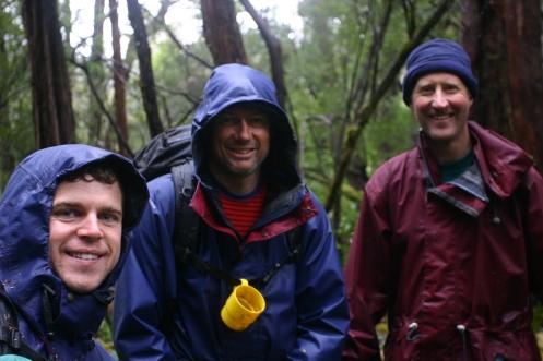 Matt, Richard, Dale, in the scrub, in the rain